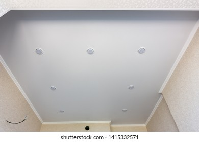 Stretch ceiling in the kitchen with perimeter-mounted spotlights