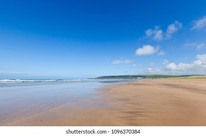 Stretch of empty beach at Saunton in North Devon, England, UK.