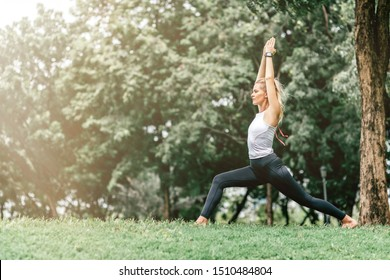 Stretch out the stress. Woman feeling peaceful and relaxed in contact with nature environment. Copy space on the left side