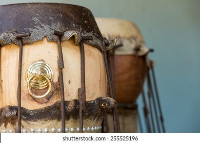 stretching animal skin making taiko drum