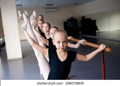 Stretching, Children in Ballet Dance Class.