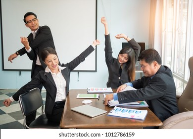 Stretching exercises for office syndrome. stretching exercise for tired employees with chair and table