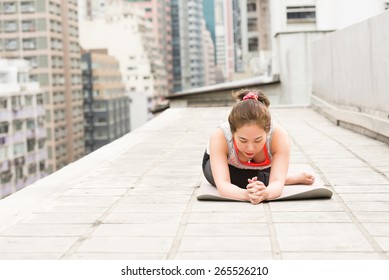 Stretching muscles on a Rooftop in Hong Kong Island