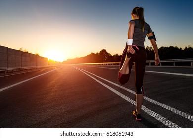 stretching run runner road jogging sunset