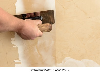 Stretching the second layer of Venetian plaster by man