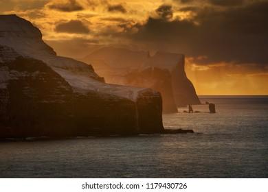 Streymoy and Eysturoy cliffs in sunset light, Faroe Islands
