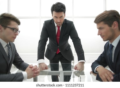 strict businessman holds a meeting with employees