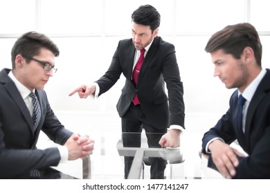 strict businessman scolds unprofessional employee.