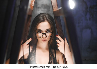 A strict girl sticks to hands for a stair with lamps, looks in a chamber. One in a shot