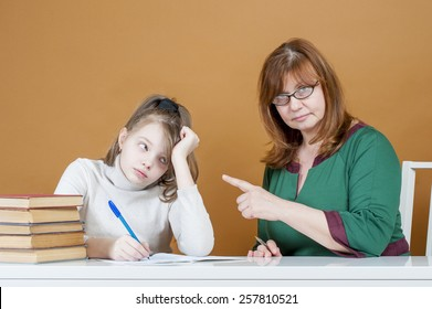 Strict woman teacher points at student.