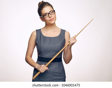 Strict woman teacher wearing glasses. portrait with wooden pointer isolated on white.