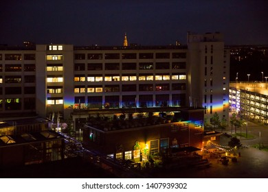 Strijp S Eindhoven, the Netherlands, June 30th 2016. Night view on the Ketelhuisplein and the Klokgebouw Strijp S with a big prism rainbow reflection projection, Eindhoven city The Netherlands