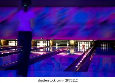 Strike in bowling. Nice shoot. Ultraviolet illumination