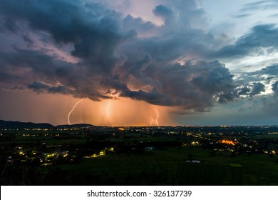 Strike of lightning, Dark clouds and lightning, High angle view of Storm and lightning over villages