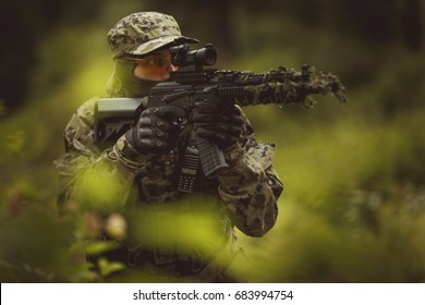 Strikeball player aiming in forest