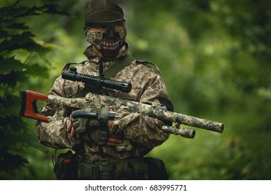 Strikeball player in camouflage,helmet