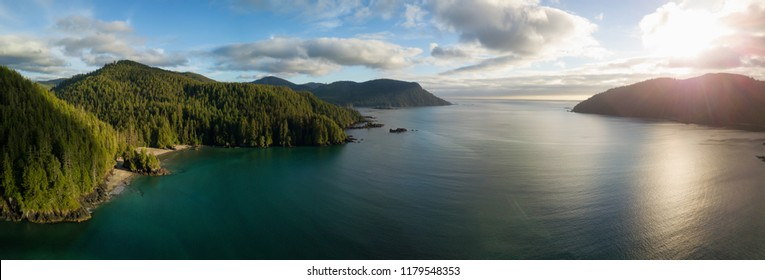 Striking aerial panoramic view of the Pacific Ocean Coast during a vibrant summer sunset. Taken in San Josef Bay, Cape Scott, Northern Vancouver Island, BC, Canada.