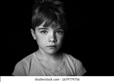 Striking blank and white portrait of a young girls with short hair