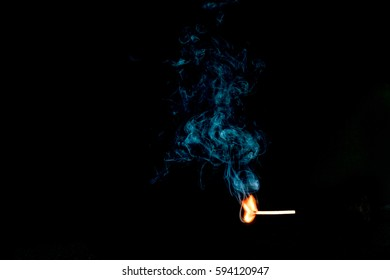 Striking Match and Billowing Smoke