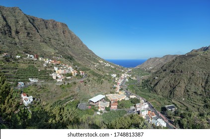 The striking mountainside of Hermigua, La Gomera, Canary Islands - in the middle of the valley the center of the town with the main street