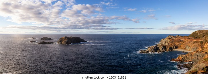 Striking panoramic seascape view on a rocky Atlantic Ocean Coast during a vibrant sunset. Taken at Crow Head, North Twillingate Island, Newfoundland and Labrador, Canada.