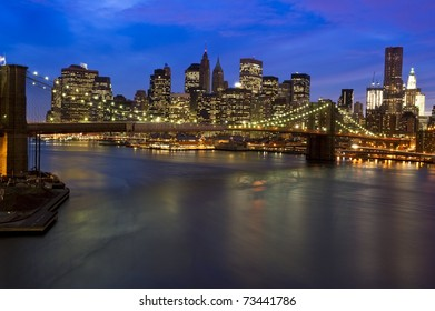 Striking photograph of downtown Manhattan Skyline and Brooklyn Bridge across the East River
