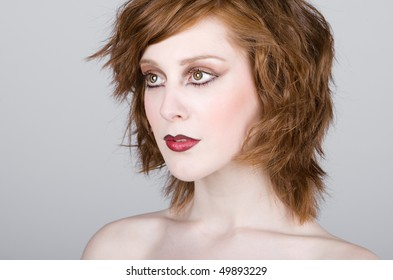 Striking Portrait of a Beautiful Red Headed Teenage Girl