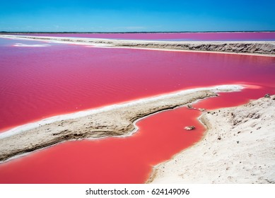 Striking red pool used in the production of salt near Rio Lagartos, Mexico