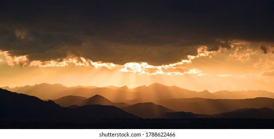 striking sunset  panorama of the front range of the colorado rocky mountains, as seen from broomfield, colorado