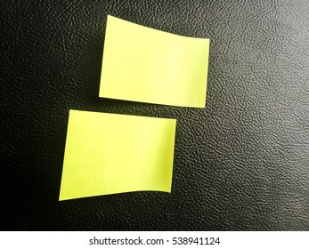 Striking yellow sticky notes on black texture background.