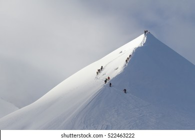 String of climbers making the ascent to the top of the mountain early in the morning, the Alps
