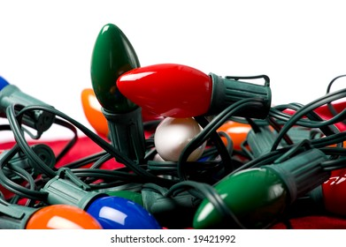 A string of colorful Christmas lights on a white background