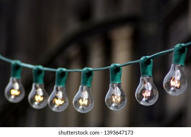 String of lightbulbs with electricty turned on