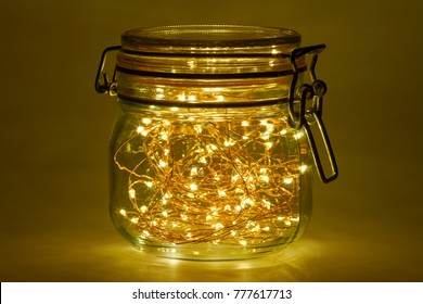 A string of lights with 100 light-emitting diodes lights up in a mason jar.