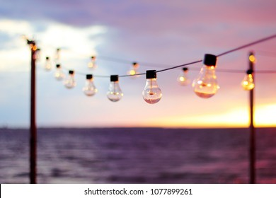 String Lights during sunset. Bulb background. Abstract background.