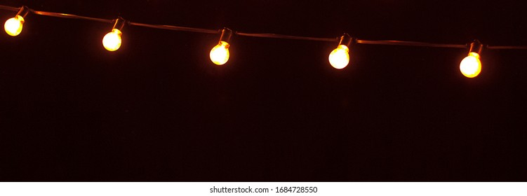 The string of lights on a dark background