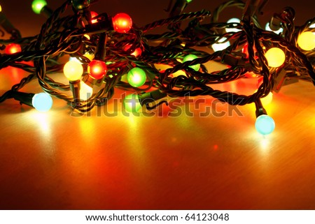 a string of little round christmas lights all bunched together