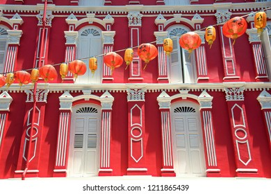 String of red Chinese lanterns strung across a street of traditional shop houses to usher in Chinese New Year of the Dog in Singapore, Chinatown