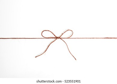 String or tied in bow on kraft paper texture.