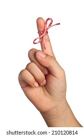 String tied on child's finger as reminder isolated on white background