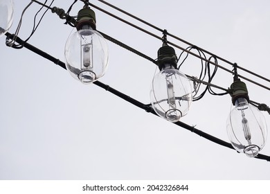 A string of tungsten lamps for fishing on a fishing boat