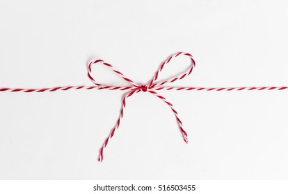 String or twine tied in bow isolated on white.