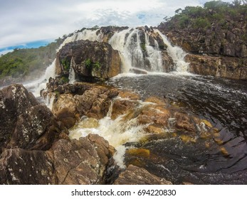 String waterfall in raining day at Chapada dos Veadeiros national park in Brazil,