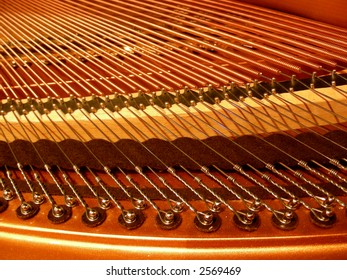 Strings and inner workings of a baby grand piano