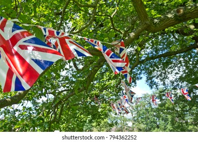 strings of union jack flags hanging in trees
