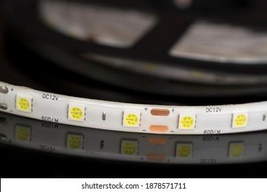 Strip Light With 5050 LEDs on black reflective surface