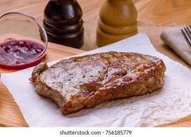 Strip loin steak on the Board