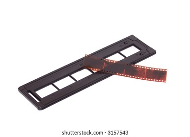 A strip of negatives and a scanner loading tray