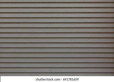 Strip texture on a gray wall