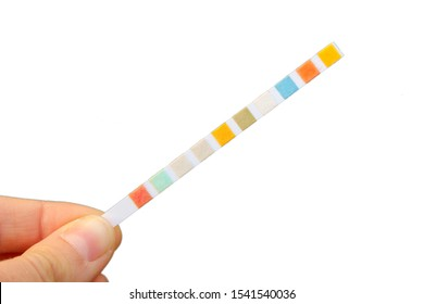 Strip for water quality measurement held in fingers (female hand). Ten multicolor squares for chemical testing of different reagents in water to identify its purity. Isolated on white background.
